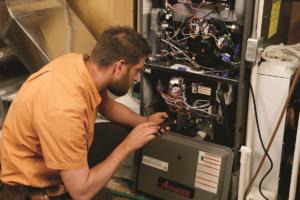 HVAC technician calibrating a furnace.